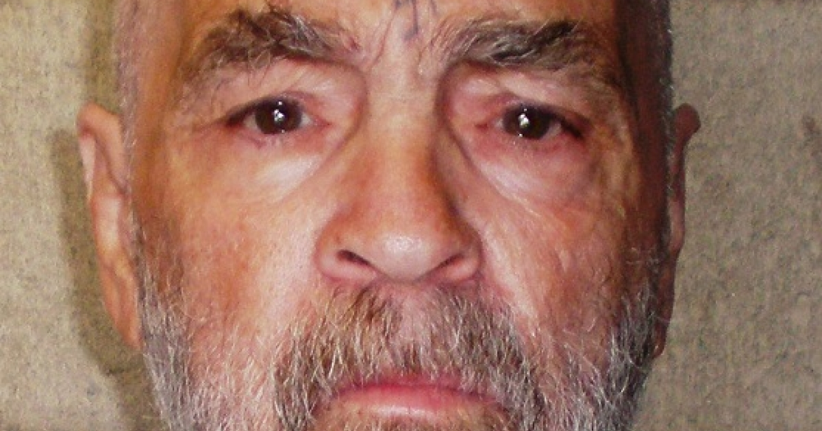 Charles Manson poses for a photo on March 18, 2009 at Corcoran State Prison, California, where he is serving a life sentence for conspiring to murder seven people during the
