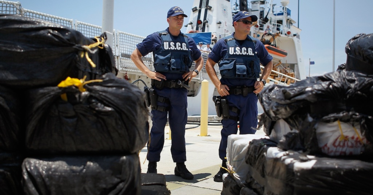 Coast Guard members next to approximately 3,800 pounds of cocaine at the Miami Beach Coast Guard Station on June 29, 2012 in Miami Beach, Florida.</p>