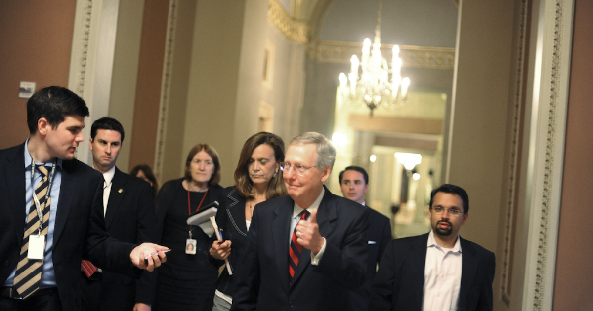 U.S. Senate Minority Leader Sen. Mitch McConnell (R-KY) gives a thumbs up when asked whether a deal has been reached regarding the ongoing debate on the national debt reduction on July 31, 2011 in Washington, DC. As the United States approaches the possibility of a default, the congressional leaders and the White House try to reach an agreement on measures to lift the debt ceiling. Congress is expected to vote on the deal August 1, 2011.</p>
