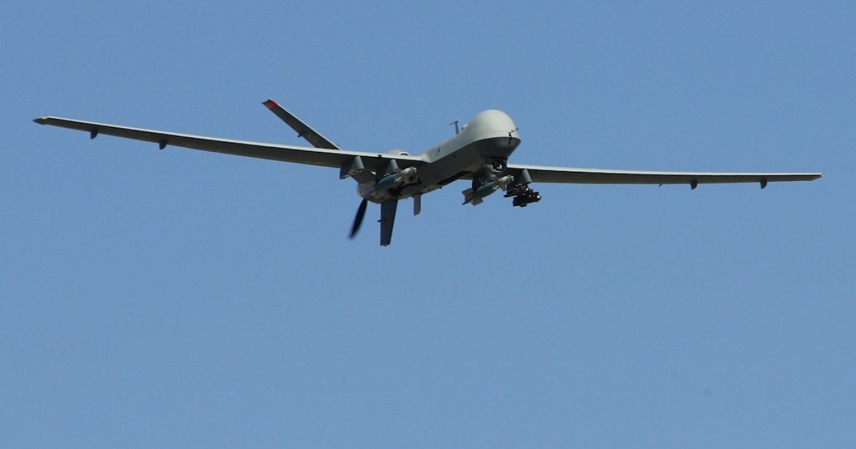 An MQ-9 Reaper flies by on a training mission Aug. 8, 2007 at Creech Air Force Base in Indian Springs, Nevada.</p>