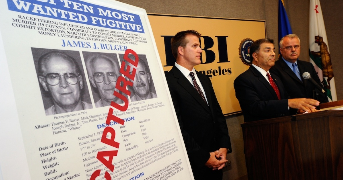 Members of the FBI and LAPD speak during a news conference to discuss the arrest of Boston crime boss James