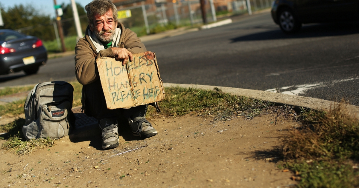 A homeless man named Bob waits for donations from passing motorists on October 11, 2012 in Camden, New Jersey. According to the U.S. Census Bureau, Camden, New Jersey is now the most impoverished city in the United States with nearly 32,000 of Camden's residents living below the poverty line.</p>