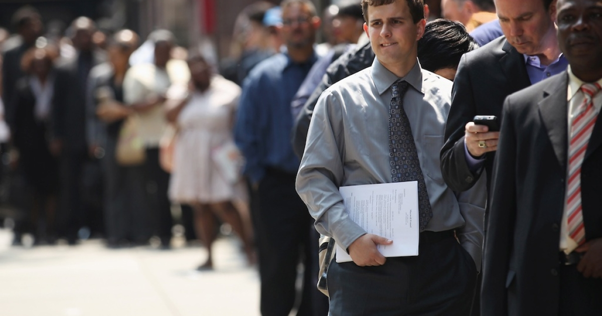 Applicants wait to enter a job fair on June 11, 2012 in New York City.</p>