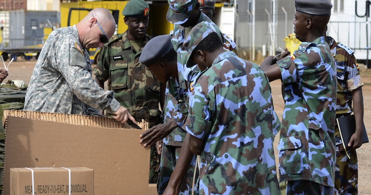 US soldiers assist Ugandan Air Force personnel package food supplies at a military airbase in Entebbbe, Uganda on Dec. 6, 2011. The food supplies were destined for Ugandan troops hunting The Lord's Resistance Army (LRA) and its chief Joseph Kony.</p>