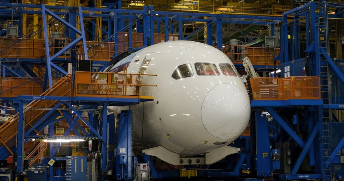 A Boeing 787 Dreamliner aircraft under construction at the Boeing production facilities in Everett, Washington, on February 17, 2012.</p>