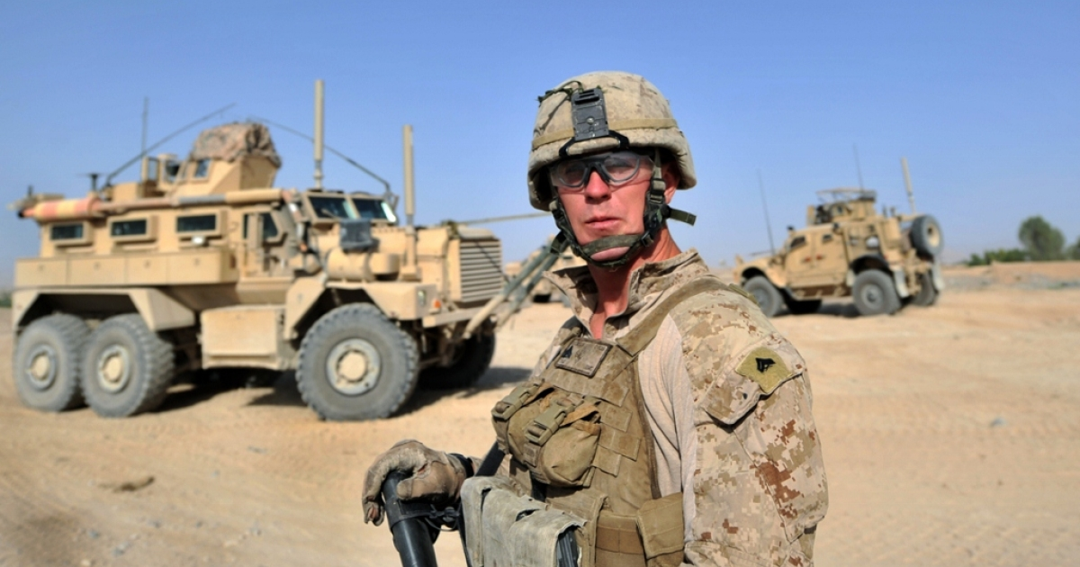 A US Marine stands guard Jun. 12, 2012 in Afghanistan.</p>
