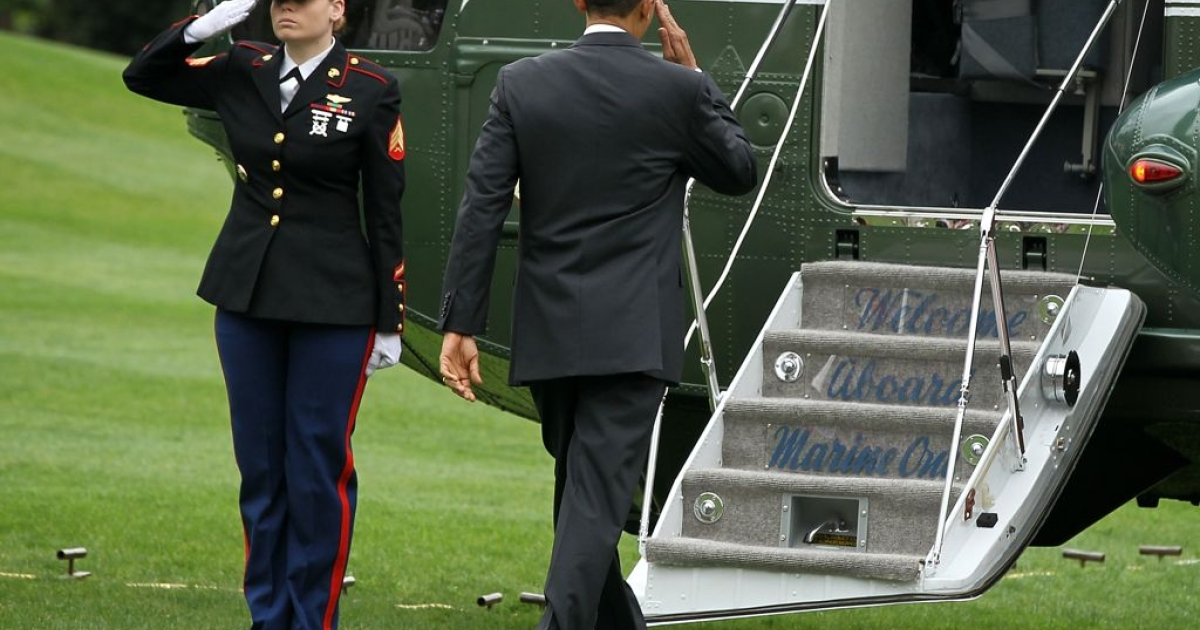 President Barack Obama salutes a US Marine on the White House lawn, on March 30, 2012. The US president is the commander-in-chief of the American armed forces.</p>