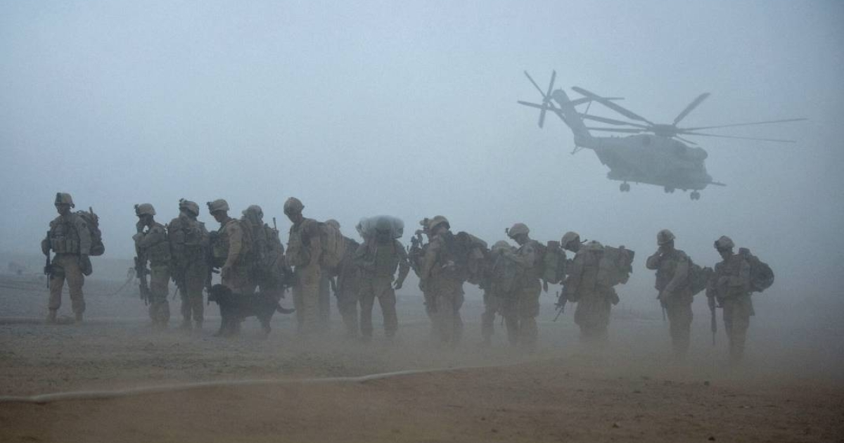 U.S. Marines from the 2nd Battalion, 8th Marine Regiment of the 2nd Marine Expeditionary Brigade wait for helicopter transport in Helmand province, southern Afghanistan, on August 9, 2011.</p>
