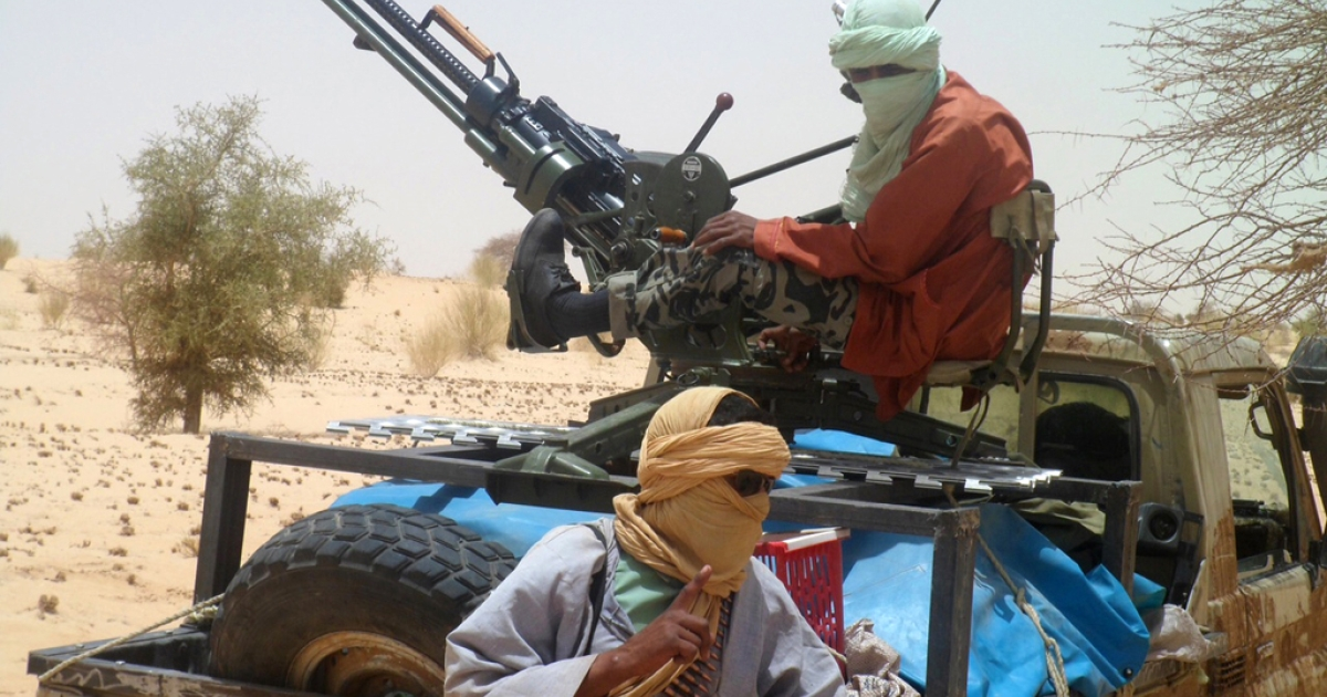 Islamist rebels of Ansar Dine are pictured on April 24, 2012 near Timbuktu, rebel-held northern Mali, during the release of a Swiss hostage. According to The Washington Post, the US military has expanded its surveillance network in Africa to keep track of militants and terrorists, using small planes equipped with sensors.</p>