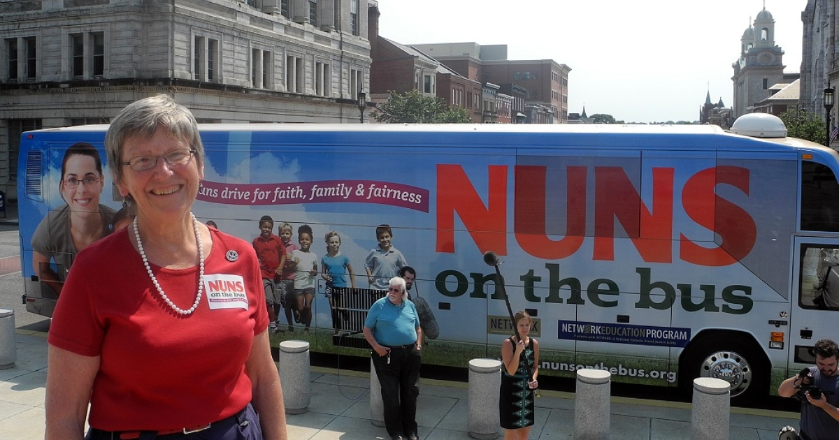 Sister Simone Campbell poses in front of the 'Nuns on the Bus' bus after arriving at the state capitol in Harrisburg, Pennsylvania on June 28.</p>