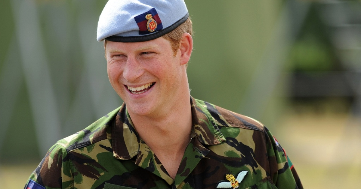 Britain's Prince Harry laughs as he speaks with RAF personnel during a visit to an RAF base in Suffolk, eastern England in July 2010.</p>