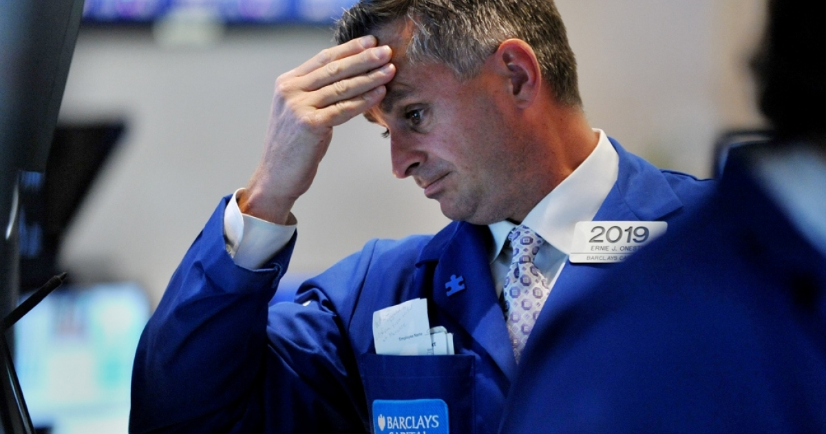 A trader reacts to the market downfall on the New York Stock Exchange, August10, 2011. US stocks plummeted, more than wiping out the gains of Tuesday's rebound. The Dow was down 519.83 points (4.62 percent) to 10,719.94 at closing, compared to its 430-point gain on Tuesday.</p>