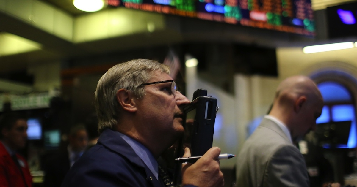 Traders work on the floor of the New York Stock Exchange on June 6, 2012.</p>