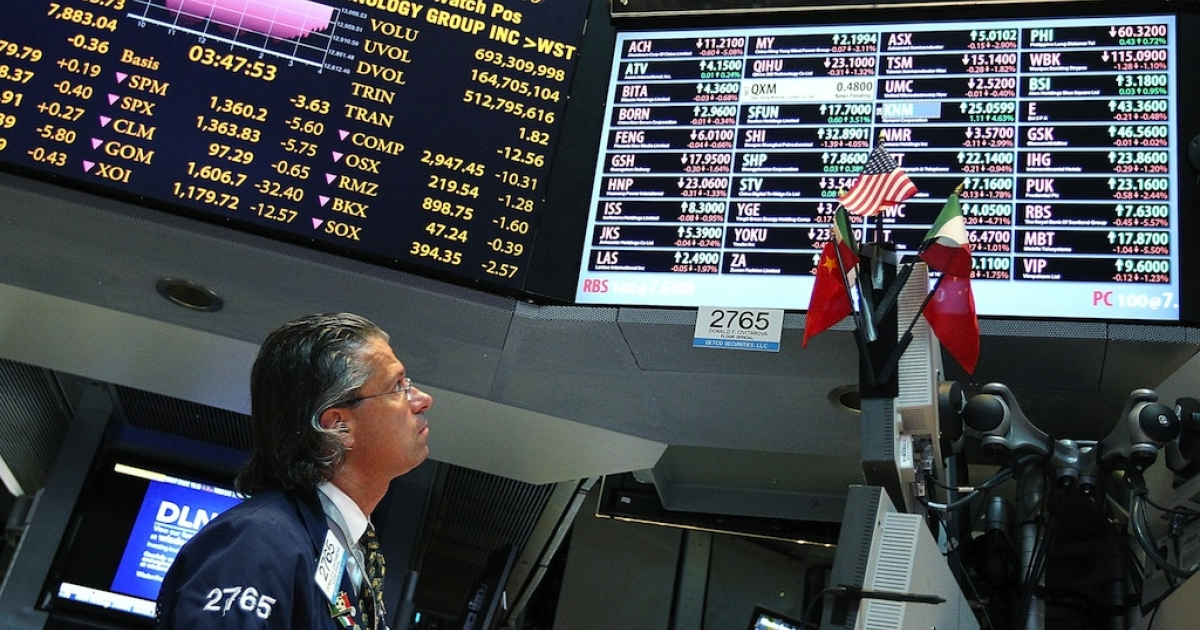 A trader works on the floor of the New York Stock Exchange on May 8, 2012 in New York City.</p>