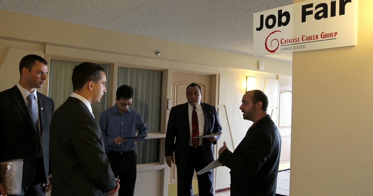 Job seekers go through an orientation at a job fair. Unemployment has been holding steady but the majority of jobless Americans are no longer receiving benefits.</p>