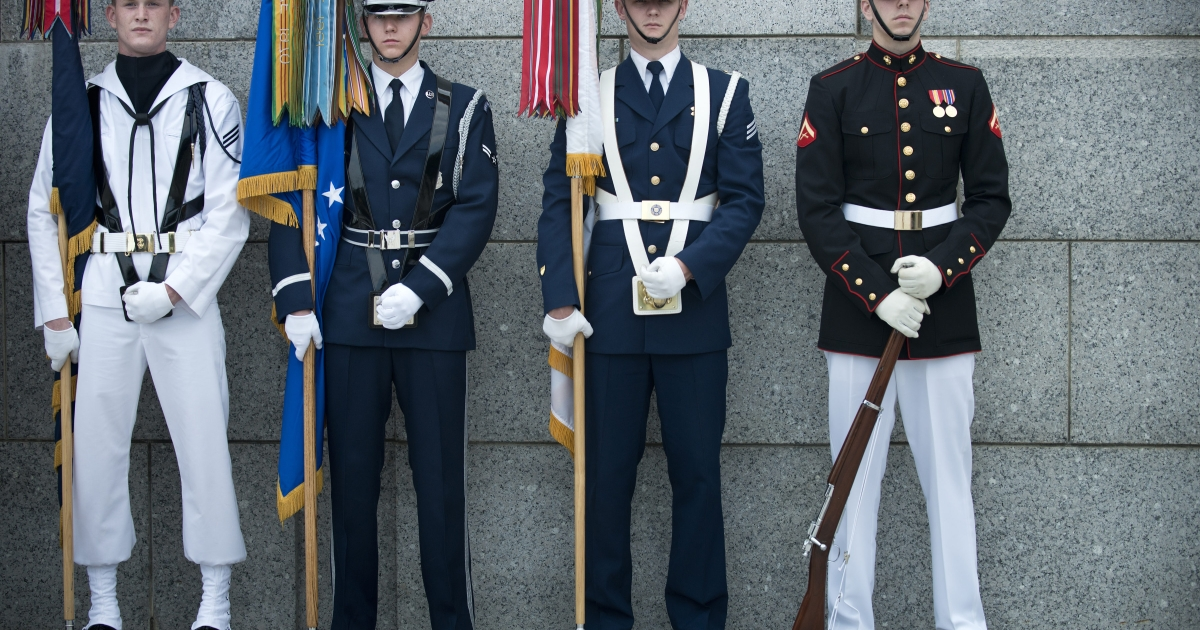 A US Military color guard stands ready for a wreath laying ceremony at the World War II Memorial on May 28, 2012 in Washington, DC.</p>