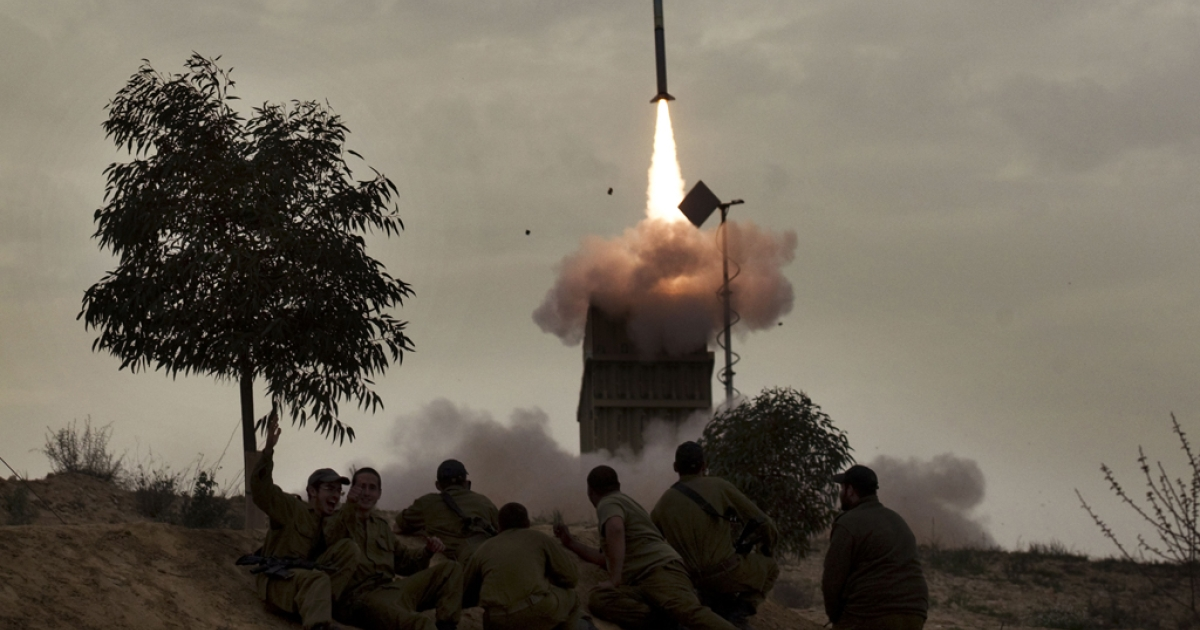 Israeli soldiers watch as a missile is launched from the Iron Dome defense system. A US war simulation of a possible scenario where Israel launched pre-emptive strikes against Iran's nuclear facilities would likely draw America into the conflict and cost hundreds of lives, a report said on March 20, 2012.</p>