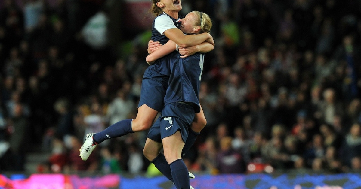 US soccer players celebrate the winning goal in the London 2012 Olympic women's football semi final match between USA and Canada at Old Trafford in Manchester, England, on August 6, 2012. USA won 4-3.</p>