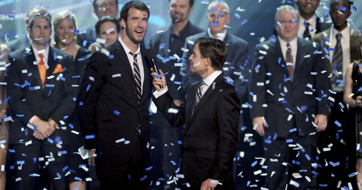 Host Bob Costas presents Jamie Tworkowski of the charity To Write Love on her Arms with the Million Dollar Giveaway onstage during the American Giving Awards presented by Chase on December 9, 2011 in Los Angeles, California.</p>