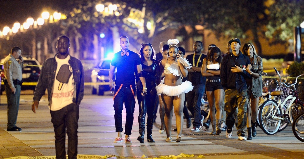 Students and people who attended a party on the campus of USC are allowed to leave after the USC campus was in lockdown after four people were shot including one in critical condition during a Halloween party at the Tutor Campus Center on November 1, 2012 in Los Angeles, California</p>