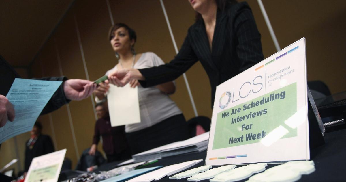Job applicants meet potential employers at a job fair in Denver.</p>