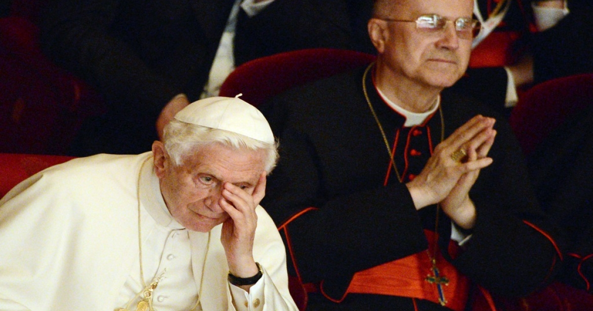 Vatican State Secretary Cardinal Tarcisio Bertone (R) and Pope Benedict XVI at La Scala theater Orchestra during a concert in Milan on June 1, 2012. Bertone is quickly becoming the target of a recent scandal involving leaked Vatican documents.</p>