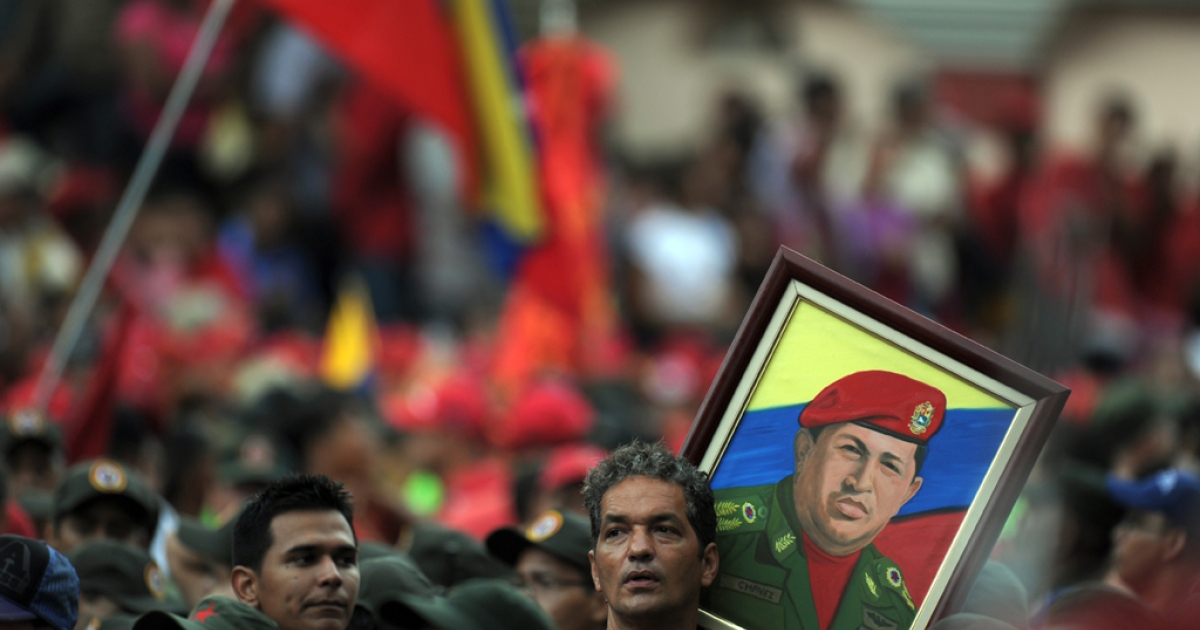 Supporters hold a portrait of Venezuelan President Hugo Chavez during the commemoration of the ninth anniversary of the failed coup against him.</p>