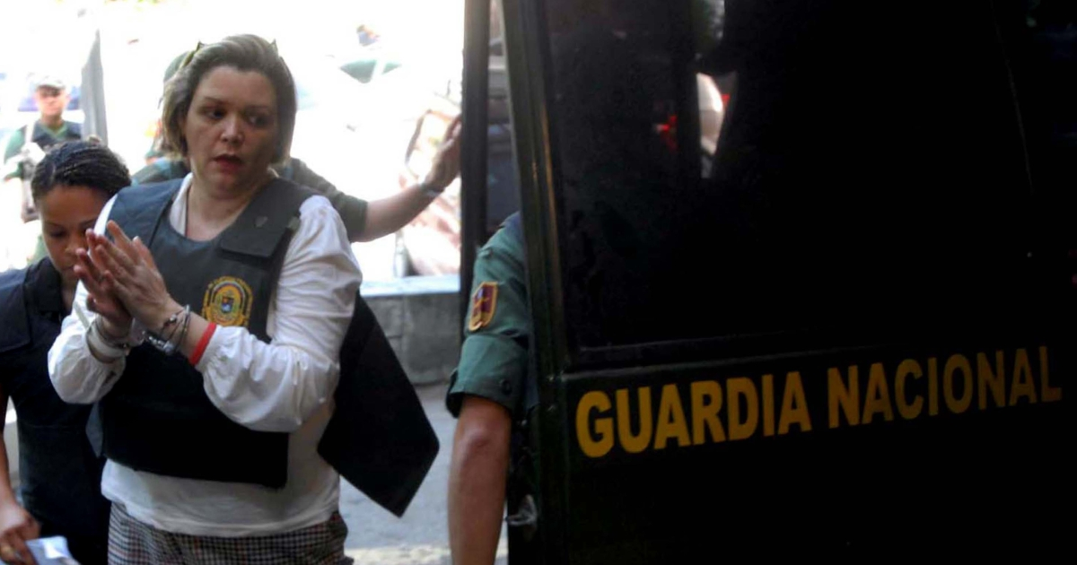 Venezuelan judge Maria Lourdes Afiuni arrives under custody at the forensic clinic in Caracas on July 16, 2010. She is involved in one of the most prominent human rights cases in Venezuela, where President Hugo Chavez is blamed for a lack of judicial independence.</p>