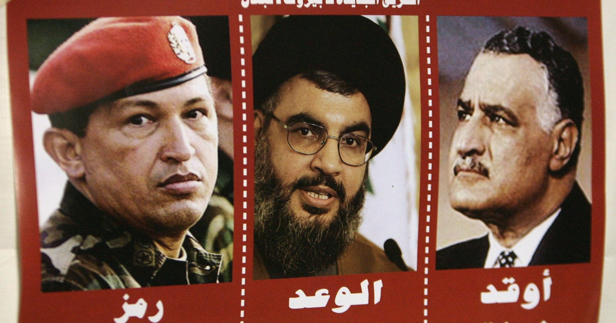 A poster in downtown Beirut, Lebanon in 2006 shows photos of Venezuelan President Hugo Chavez, Hezbollah Secretary General Hassan Nasrallah and former Egyptian President Jamal Abdel Nasser. The text beneath each translates, respectively, as