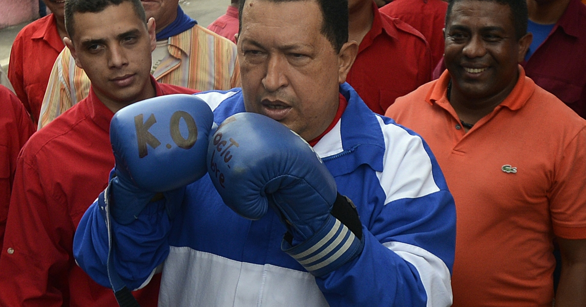 Venezuelan President Hugo Chavez wears boxing gloves during a campaign rally in Acarigua, northwestern Venezuela, on Sept. 24, 2012. Chavez is seeking a third term to extend his 13-year rule of the oil-rich South American country.</p>