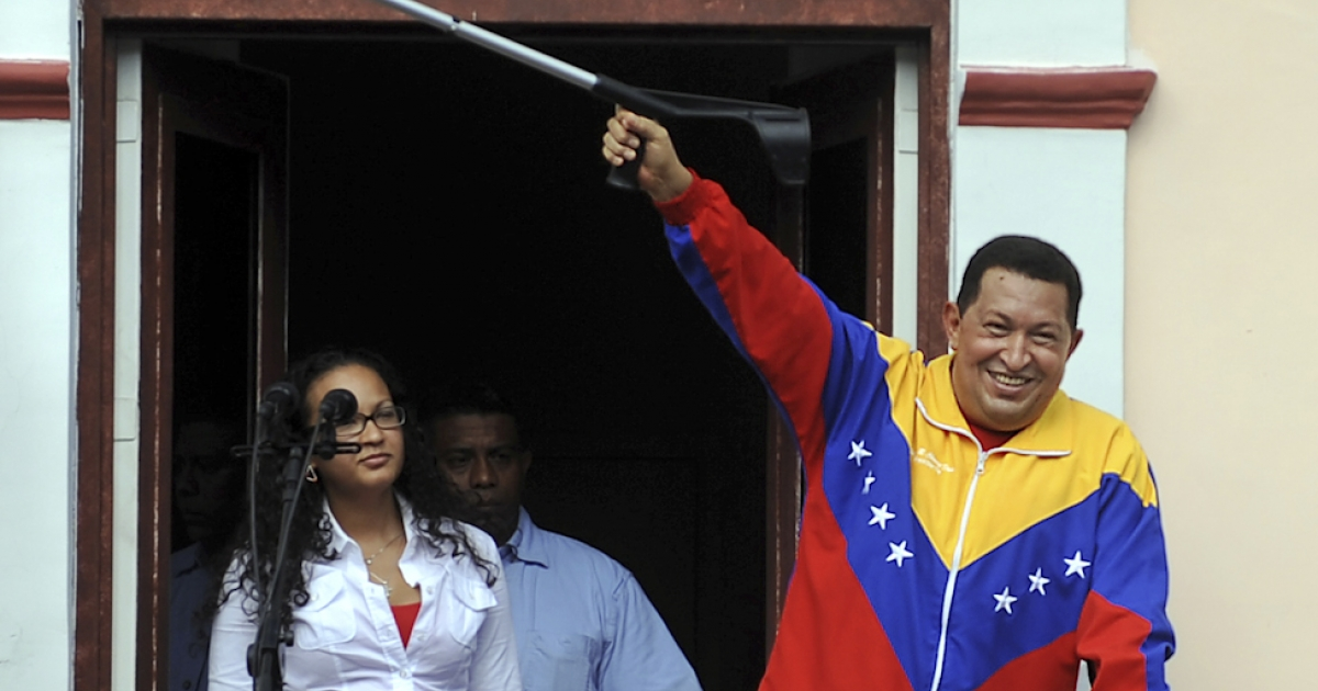 "Venezuelan President Hugo Chavez raises a crutch after his weekly program ""Alo Presidente,"" in Caracas, on May 22, 2011. There is growing concern about Chavez's health two weeks after he underwent surgery in Cuba for what authorities said was a pelvic abscess.</p>"