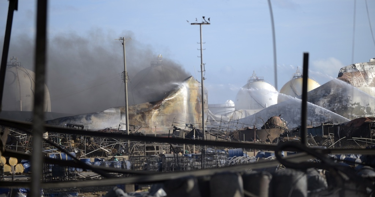 View of the devastation caused by a blaze in the Amuay oil refinery on August 28, 2012 in northern Venezuela.</p>