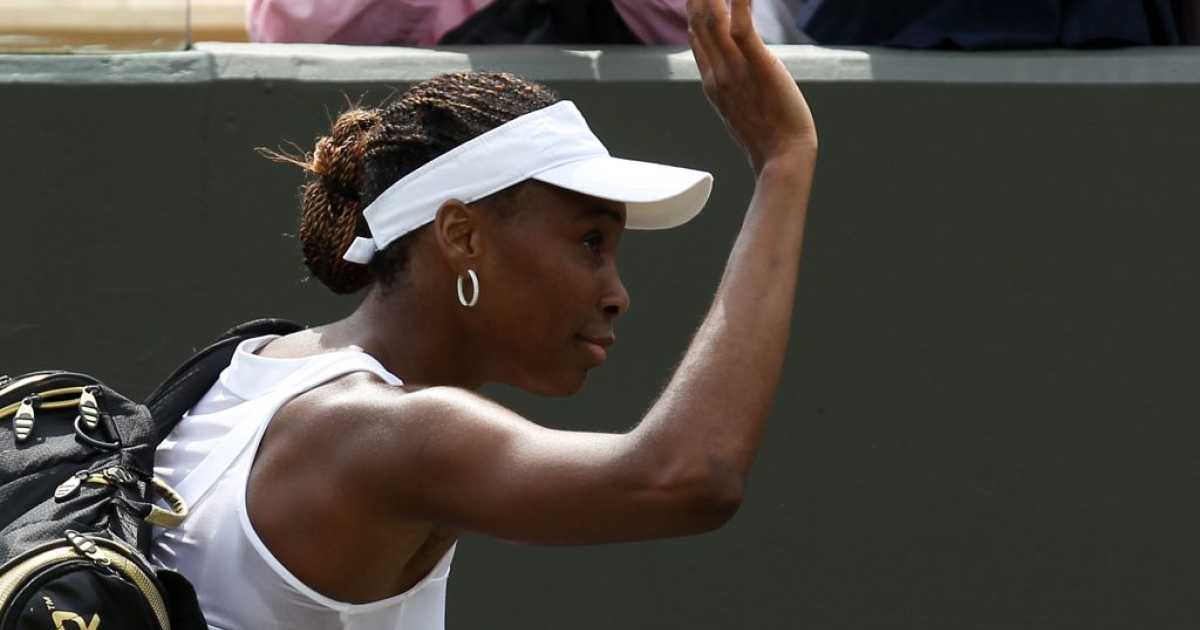 Venus Williams waves goodbye to the crowd after crashing out of Wimbledon on day one.</p>