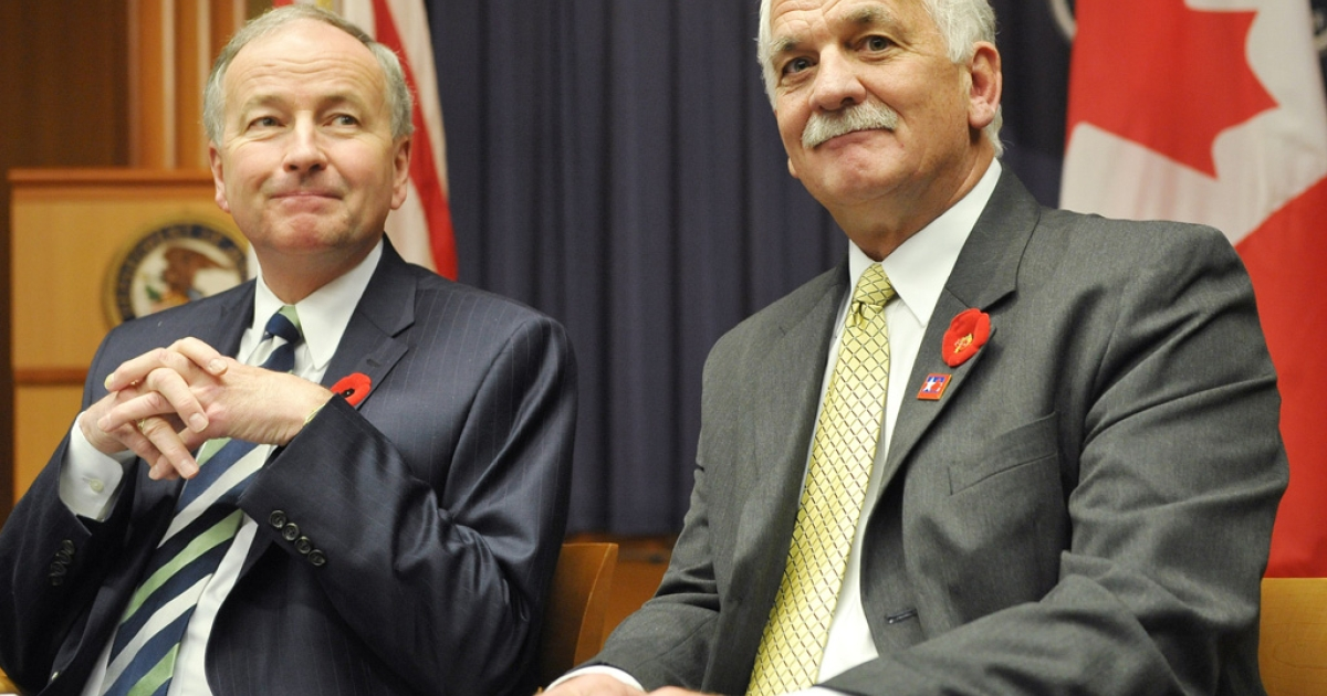 Canada's Minister of Justice Rob Nicholson, left, and Public Safety Minister Vic Toews attend the 2010 Cross-Border Crime Forum in Washington, DC. A leaked document says Toews told Canada's spy agency it can share information with foreign governments even if that intel leads to torture.</p>