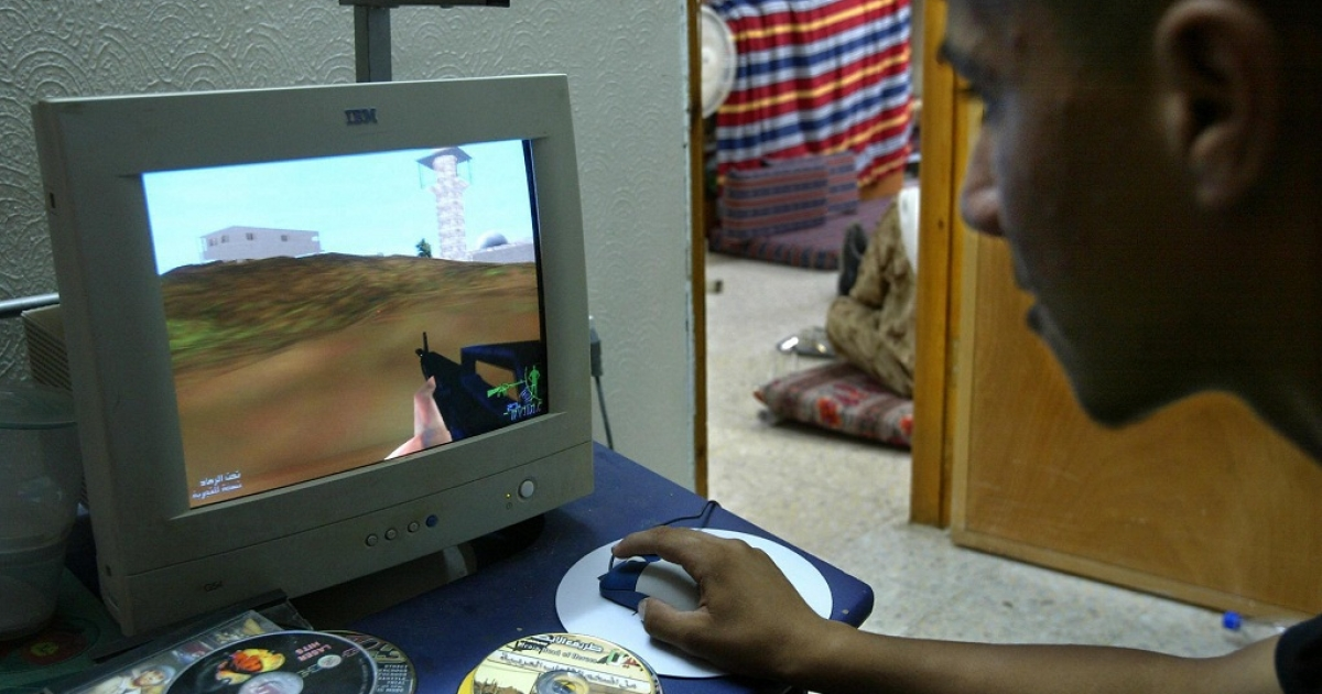 Tarek Owweis plays a videogame call 'Jenin street of Heros' in Jenin in the West Bank 22 September 2004. The fiercest fighting of the entire intifada took place in Jenin in April 2002 when 23 Israeli soldiers and around 50 Palestinians were killed in a vast army raid, dubbed Operation Defensive Shield. Ever since, Jenin and its refugee camp, comprising 70,000 inhabitants, have been seen as the ultimate symbols of the Palestinian struggle against Israeli occupation.</p>