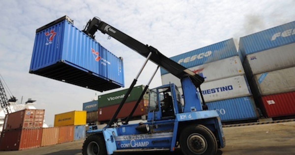 A forklift removes a container at Saigon Port in Ho Chi Minh City on March 6, 2008.</p>