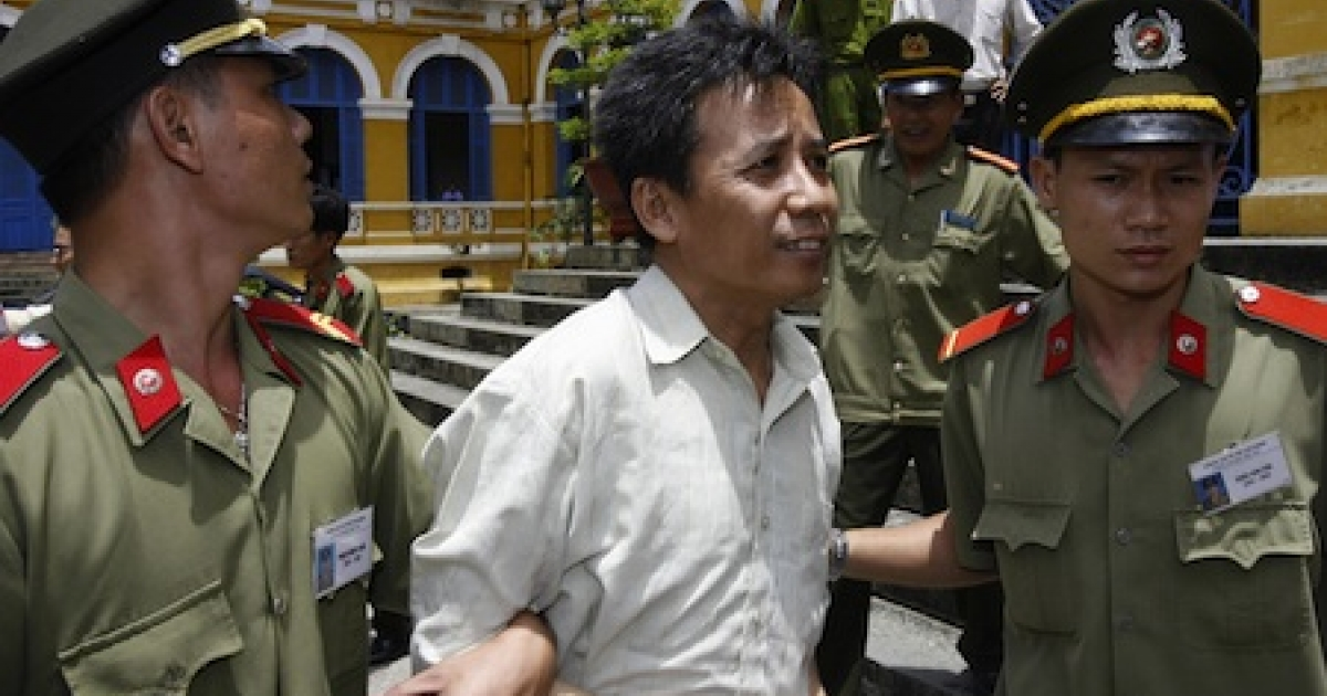 Vietnamese political dissident Le Nguyen Sang is led out a Ho Chi Minh City court after being sentenced to a five-year jail term in 2007.</p>