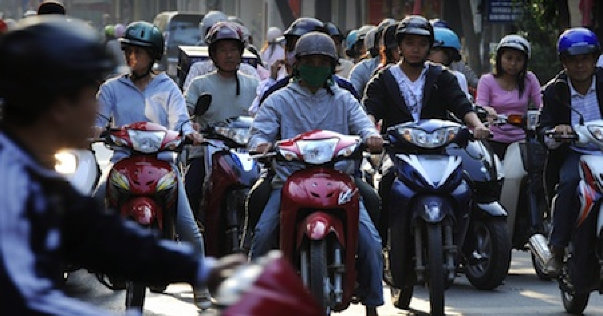 A typical traffic scrum in Hanoi, Vietnam.</p>