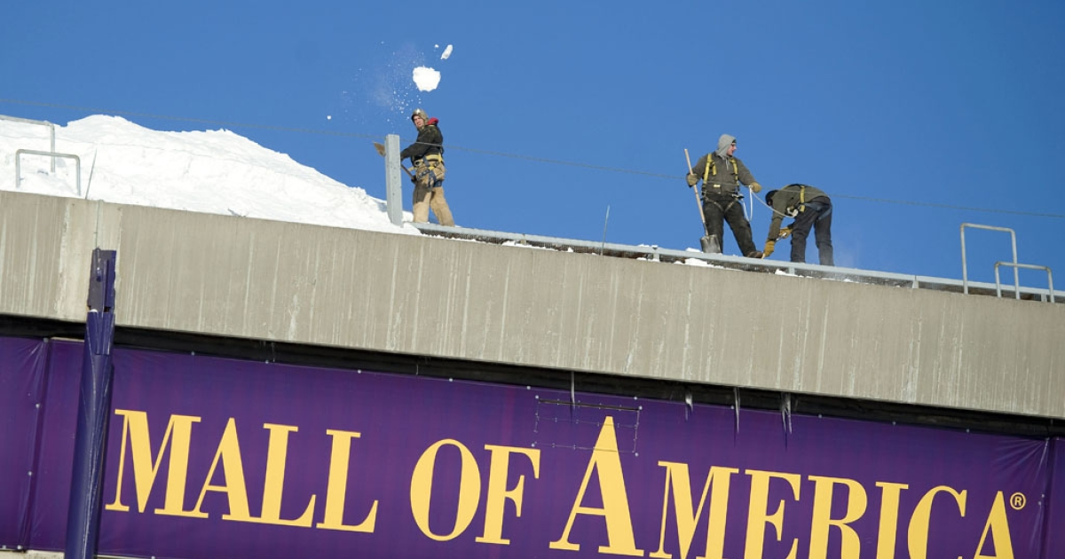 Workers shovel snow from the Hubert H. Humphrey Metrodome after the inflatable roof collapsed after a storm on Dec. 12, 2010, in Minneapolis. On Monday, state lawmakers advanced a bill that would build a $975-million stadium to replace the Metrodome.</p>