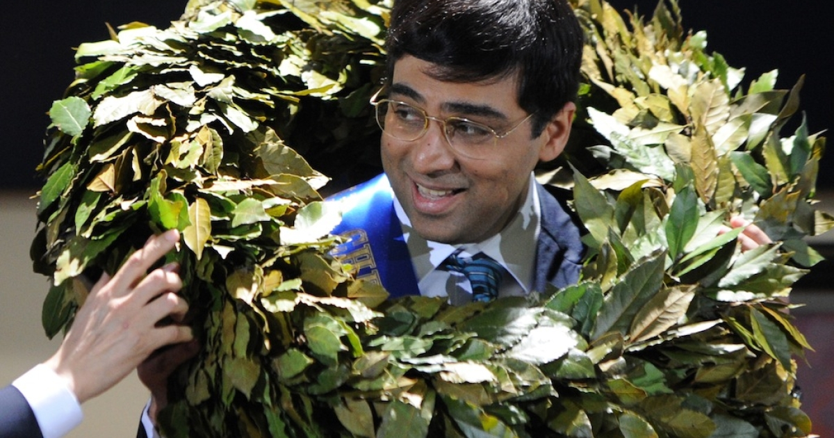 India's defending world chess champion Viswanathan Anand is garlanded in the award ceremony of the FIDE world chess championship match in Tretyakov Gallery in Moscow on May 31, 2012.</p>