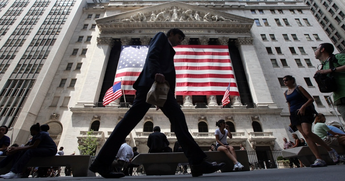 People walk past the New York Stock Exchange during afternoon trading on August 4, 2011 in New York City.</p>