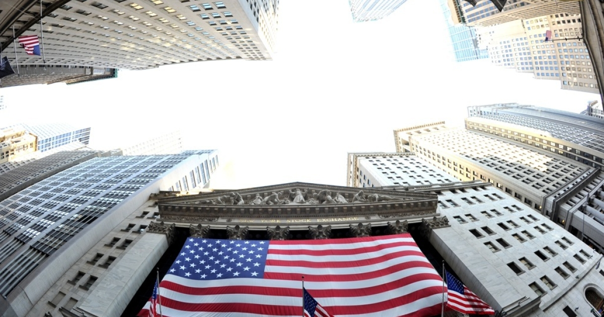 A large American flag draped across the front of the New York Stock Exchange August 5, 2011.</p>