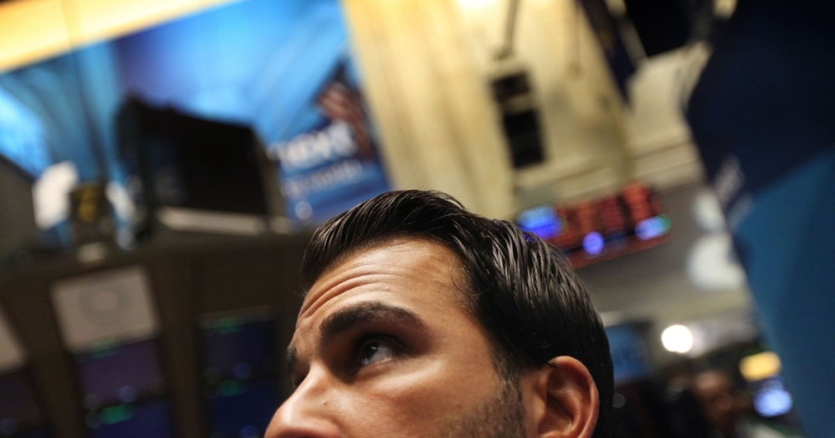Traders on the floor of the New York Stock Exchange on Aug. 10, 2011.</p>