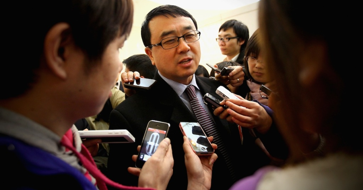 Chongqing's Wang Liqun answers media questions after a meeting during the annual National People's Congress at the Great Hall of the People on Mar. 6, 2011 in Beijing, China.</p>
