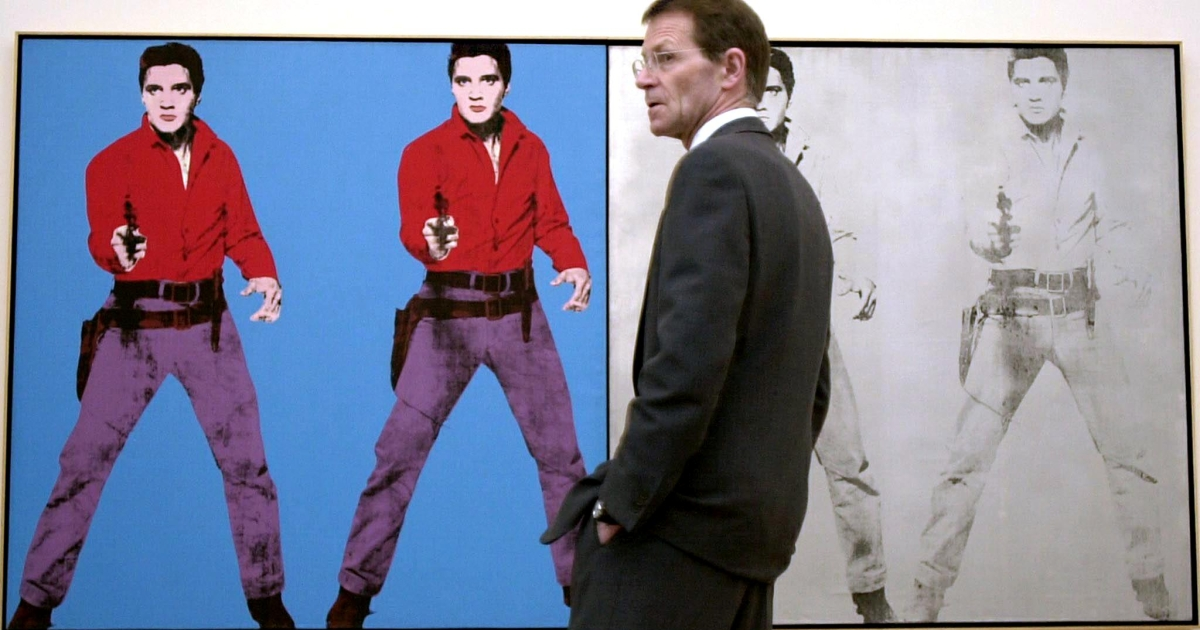 In London, Tate Modern director Nicholas Serota stands in February 2002 in front of an Andy Warhol work featuring Elvis Presley.</p>