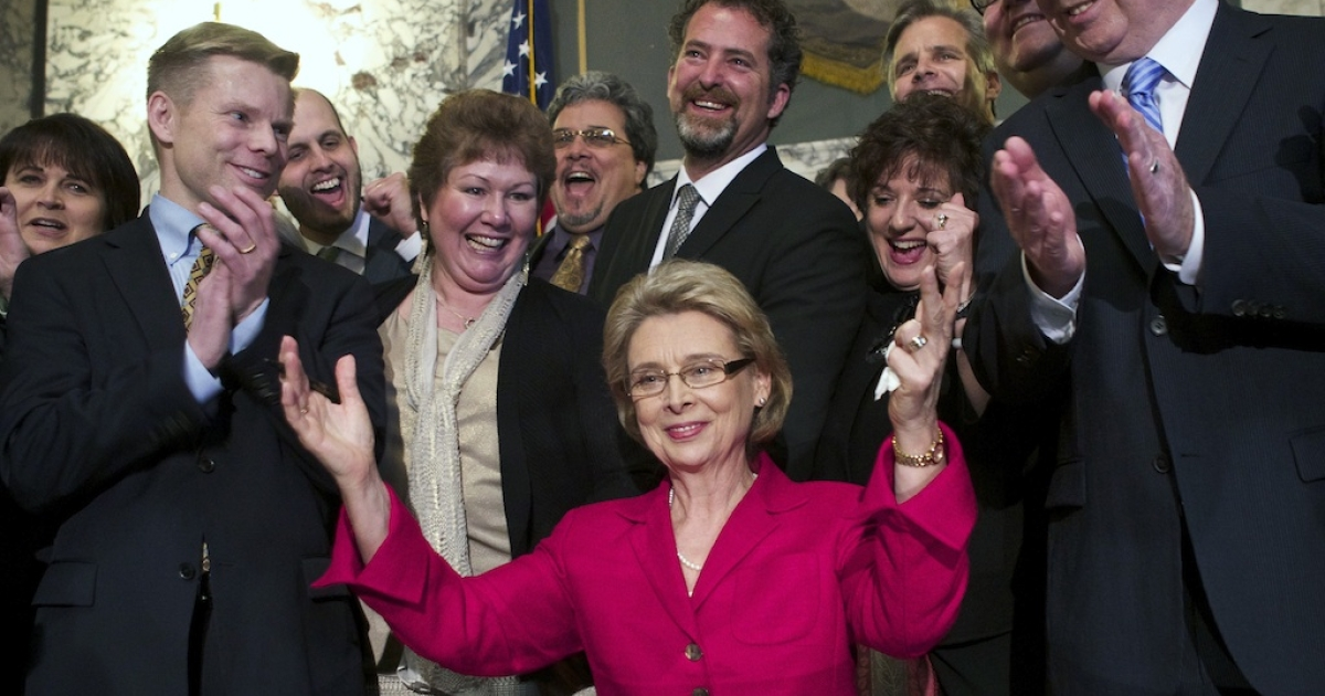 Washington State Governor Chris Gregoire, center, celebrates, with State Rep. Jaime Petersen, far left, State Senator, far right, after signing marriage equality legislation into law February 13, 2012 at the state capitol in Olympia, Washington. Washington voters will cast their ballots on the issue in November, after anti-gay-marriage organization Preserve Marriage Washington submitted enough signatures to the Secretary of State.</p>