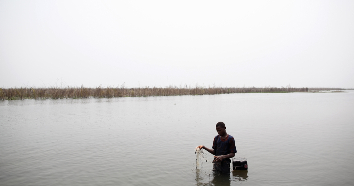 A boy fishes with a net in the lagoon in Ganvie, near Cotonou, Benin. Leaders at the World Water Forum in Marseilles warned that radical policy changes need to be made in order to stem a water scarcity crisis.</p>