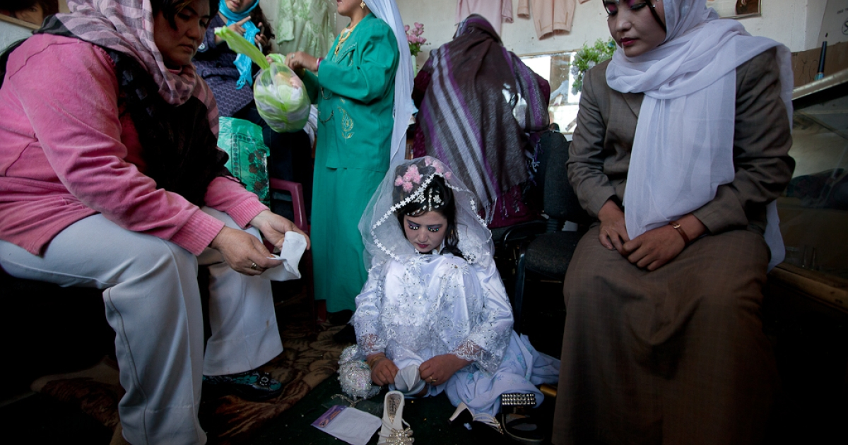 Afghan bride Zahara,  24, gets ready for a wedding ceremony surrounded by female family members at a local beauty parlor in Bamiyan, Afghanistan. Oct. 14, 2010.</p>