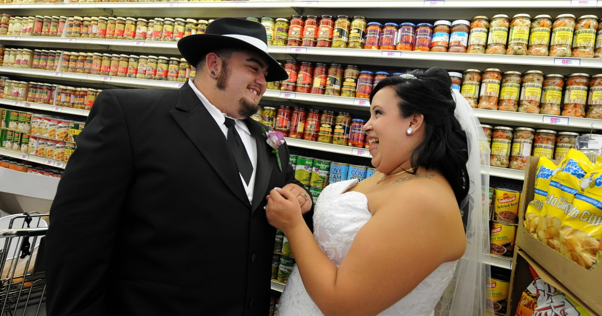 Lesley Barragan and John Tinker smile as they look at the rings after their 99 cent wedding ceremony at the 99 cent store in Los Angeles on September 9, 2009.</p>