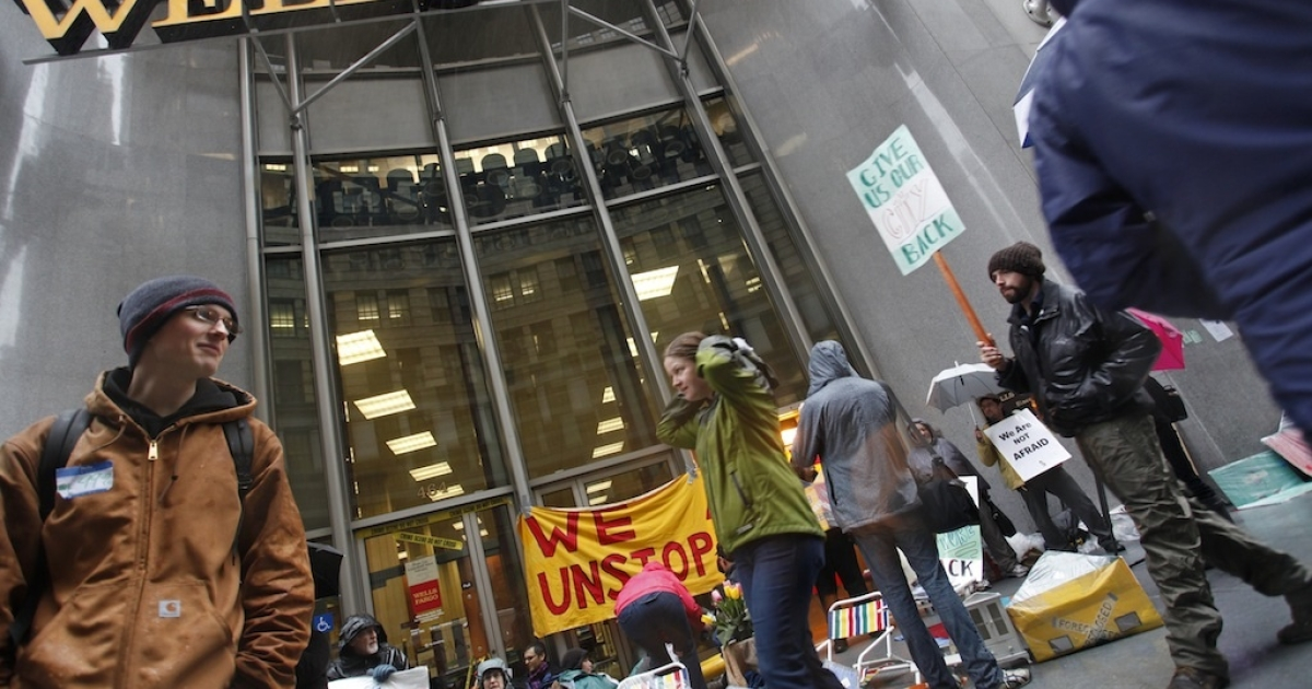 Occupy San Francisco protesters march outside a Wells Fargo branch in San Francisco's financial district to protest against major banks in January.</p>